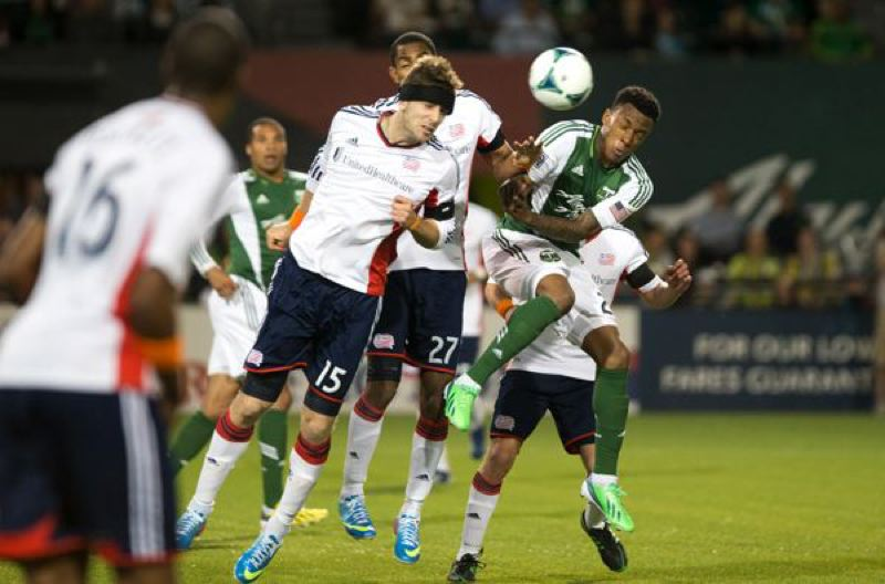 by: TRIBUNE PHOTO: CHRISTOPHER ONSTOTT - The Portland Timbers' Diego Chara battles for the ball as the home team ties New England 0-0 at Jeld-Wen Field on Wednesday, running the Timbers' MLS unbeaten streak to seven games.