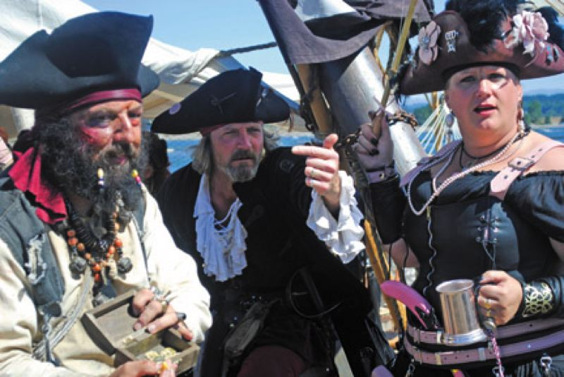 by: SPOTLIGHT FILE PHOTO - Pirate crew members in full costume welcome festival goers at last years Portland Pirate Festival in St. Helens. The event will be smaller this year as organizers rest and regroup.