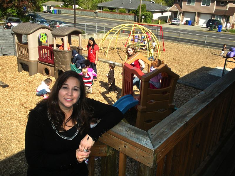 by: OUTLOOK PHOTO: JIM HART - Suzette Matthews, owner of Small World Learning Center, is seen just outside one of the classrooms at her day care center that serves youngsters age 6 months to 12 years.
