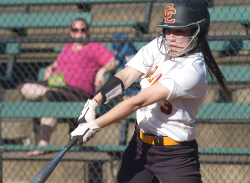 by: PAMPLIN MEDIA GROUP: DAVID BALL - Central Catholics Hailey Frilot takes a swing during Fridays 9-1 win over Reynolds.
