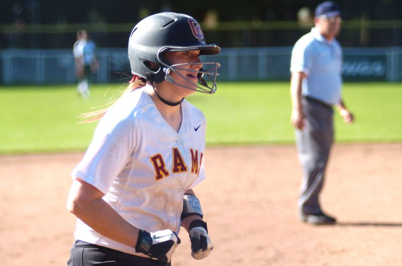 by: PAMPLIN MEDIA GROUP: DAVID BALL - Central Catholics Baylee Westrick trots home after banging a two-run homer in the third inning.
