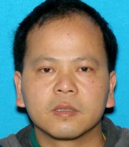by: COURTESY OF PORTLAND POLICE BUREAU - Portland murder suspect Le Huang was arrested Friday, May 3, in Seattle. He is awaiting extradition to Oregon.