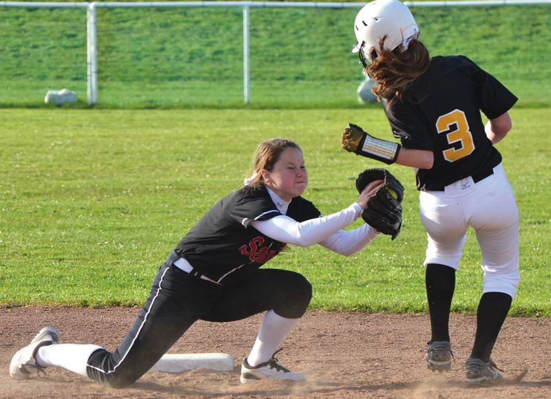 by: PAMPLIN MEDIA GROUP: JOHN BREWINGTON - Sandy shortstop Haley Valitski reaches out to tag out St. Helens runner Steve Strawn on a steal attempt in the sixth inning.