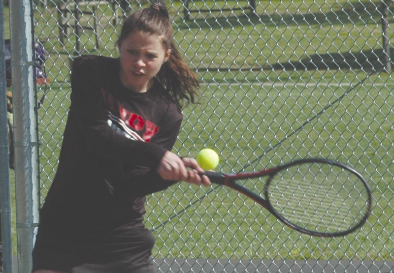 by: THE POST: PARKER LEE - Sandys Lindsay Shields makes a backhand return during last weeks 7-2 loss to Sherwood. Sandy finished second in the NWOC.
