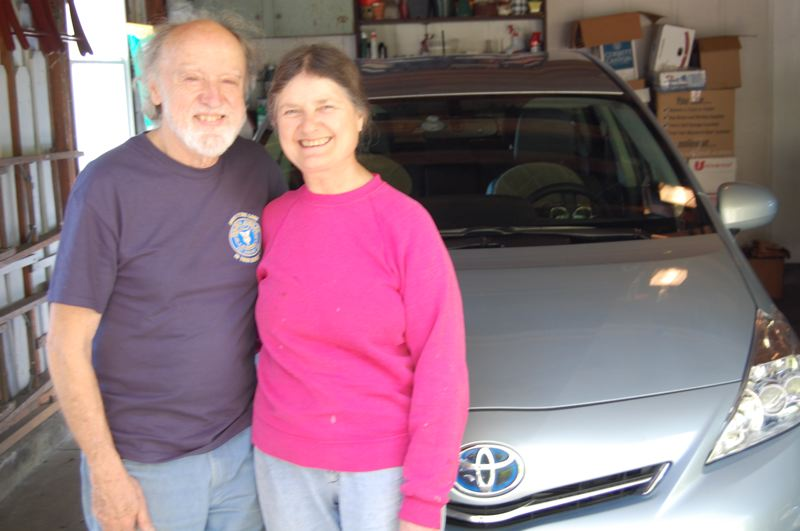 by: PHOTO BY: RAYMOND RENDLEMAN - Oak Grove residents John and Sherien Jaeger share a love of solar panels and a Prius in addition to their classic cars.