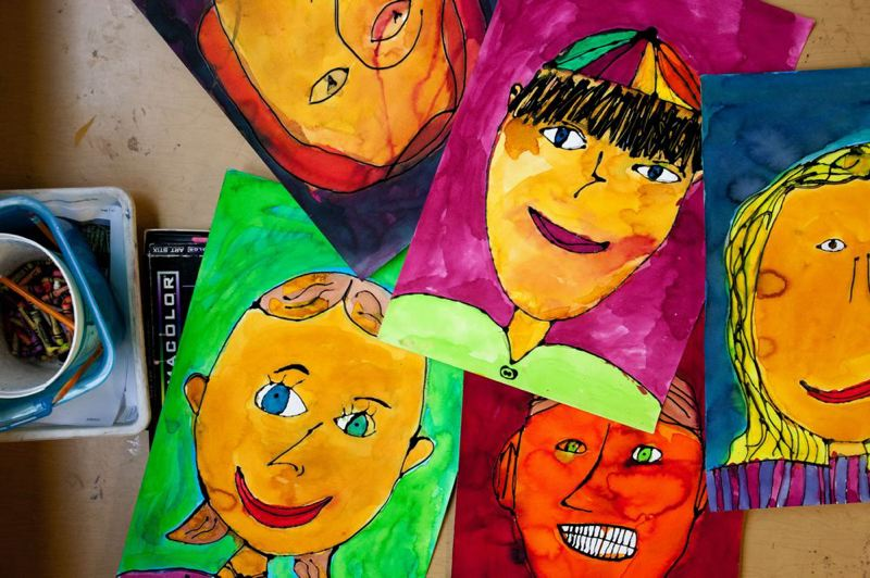 by: TRIBUNE PHOTO: CHRISTOPHER ONSTOTT - Self portraits by students at Sabin Elementary School were sold to raise funds one of the few surviving art porgrams in Portland Public Schools that has not been cut. A new city arts tax is still in limbo because of legal challenges and refund issues.