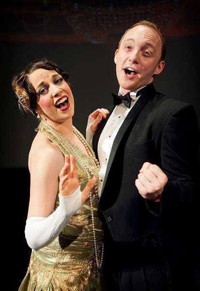 by: COURTESY PHOTO: CASEY CAMPBELL AND BAG&BAGGAGE PRODUCTIONS - Megan Carver, playing Natasha, and Benjamin Farmer, playing Adam, serenade the crowd in the 1920s-style farce on the high seas.
