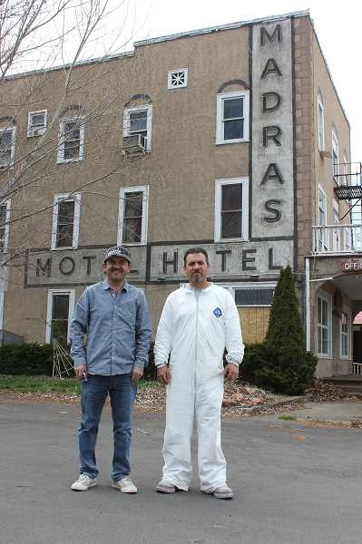 by: PHOTO BY SUSAN MATHENY - Miguel Segoviano, left, and Rafael Ortega take a break from working at the Madras Hotel. Segoviano, who recently purchased the property, plans to knock down the century-old hotel but will try to resell the connecting motel.
