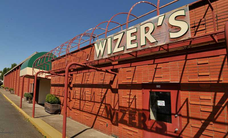 by: VERN UYETAKE - Eyed for redevelopment for years, the block where Wizer's has been located for decades is now poised for a transformation into apartments and retail spaces.