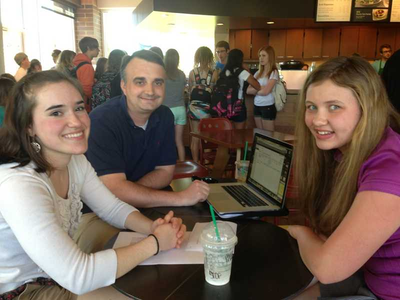 by: TIDINGS PHOTO: LORI HALL - From left, Kelsey Douglas, City Councilor Thomas Frank and Madison Staten recently met at Starbucks to talk about the work the teens are doing as his ambassadors.