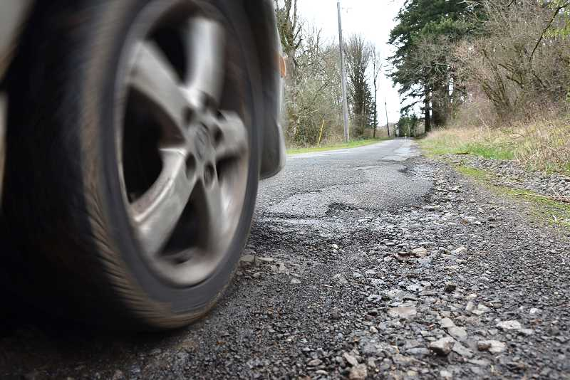 by: TIDINGS FILE PHOTO: VERN UYETAKE - Bland Circle, between Fircrest Drive and Weatherhill Road is one of the worst streets in West Linn. The road is narrow and has deteriorated.