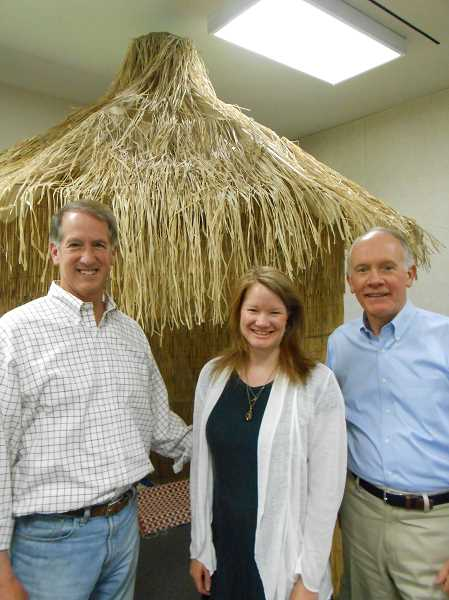 by: CLIFF NEWELL - One example of Lake Grove Presbyterian Church's affinity with Senegal is a replica of a village hut in the church. Pictured are Alan Shiffer, Susie Graham and the Rev. Bob Sanders.