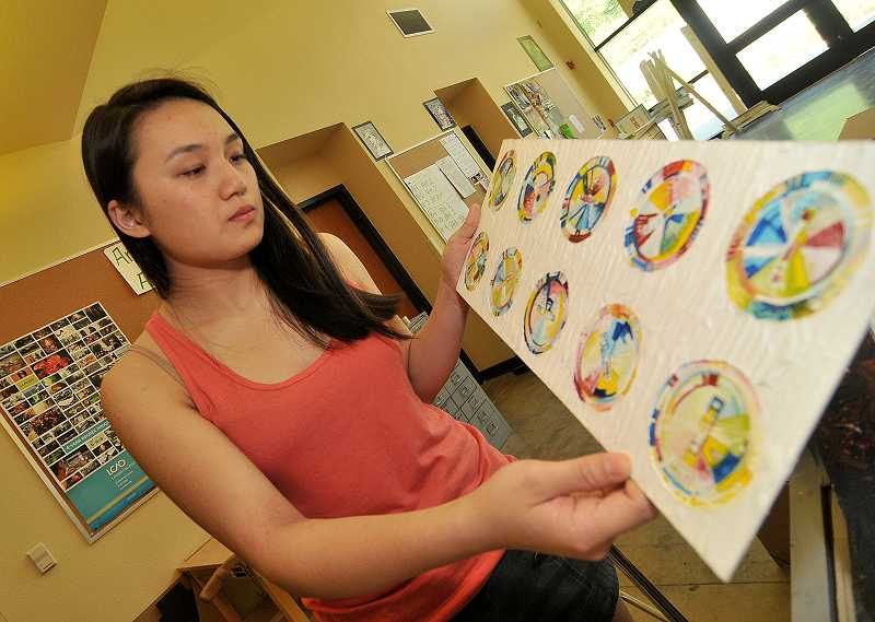 by: REVIEW PHOTO: VERN UYETAKE - Amy Chen won thousands of dollars for her school in an art contest.