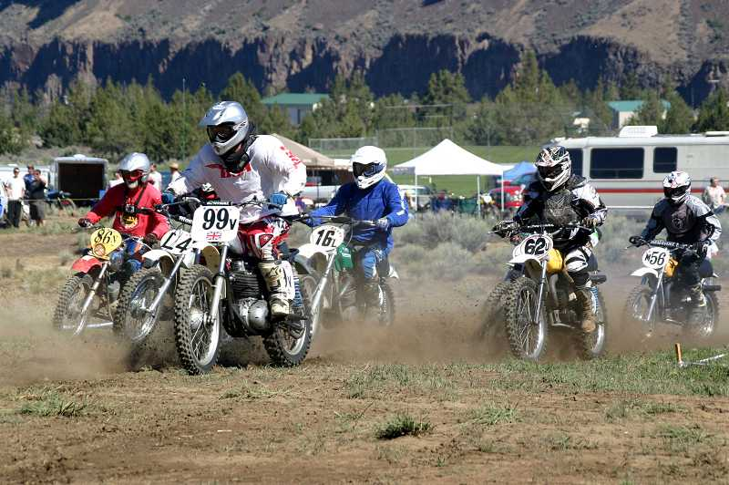 by: RAGINA ANDERSON - Competitors in the 60-plus class take off from the starting gate on Sunday, during the motocross races at the sixth annual Steel Stampede at Crooked River Ranch. A total of 194 people competed in motocross, and 72 in Saturday's trials - the most ever, according to Nicol Fisher, president of Powroll Motor Performance, which is the main event sponsor.