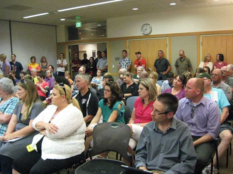 by: TIMES PHOTO: RAY PITZ - Sherwood residents packed the Sherwood City Council chambers Tuesday night to express opposition to the proposed Walmart store.