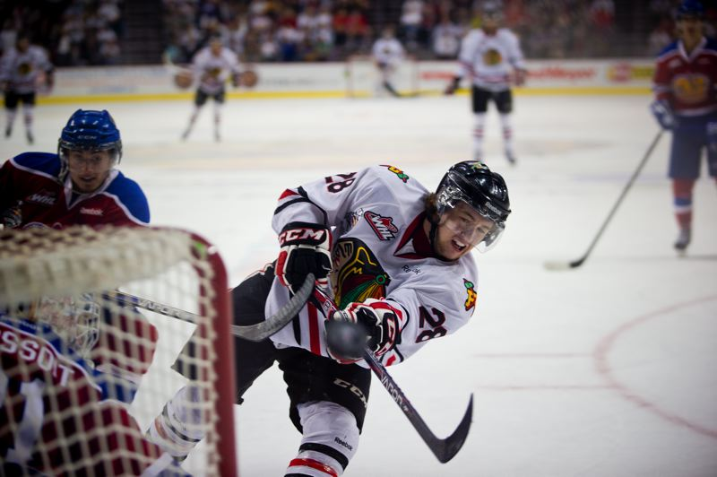 by: TRIBUNE PHOTO: CHRISTOPHER ONSTOTT - Brendan Leipsic, who shared the Western Hockey League scoring title with teammate Nicolas Petan, fires a shot on goal for the Winterhawks.