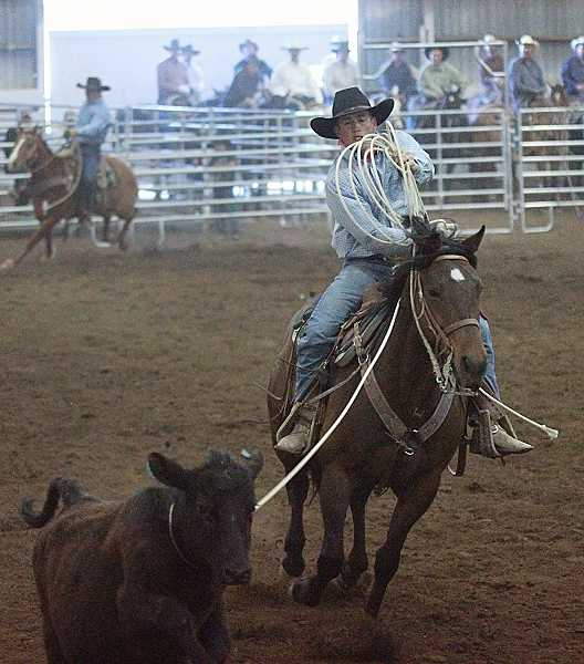 by: BILLY GATES/THE PIONEER - Chance Pelia of Green Livestock ropes a calf in the muley team roping event during the second annual Tom Green Memorial Ranch Rodeo, held Saturday night at the Jefferson County Fairgrounds. Pelia helped Green Livestock to the all around team victory.