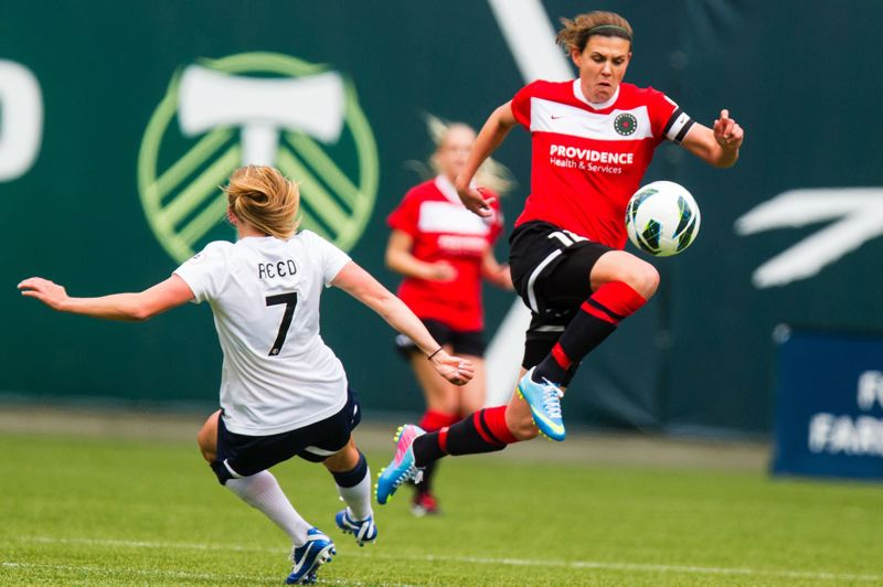 by: TRIBUNE PHOTO: CHRISTOPHER ONSTOTT - The National Womens Soccer Leagues first player of the month is Portland Thorns FC striker Christine Sinclair, leaping to gain control of the ball and avoid Seattle Reign defender Elli Reed.
