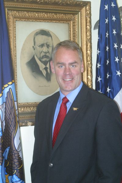 by: PHOTO COURTESY OF SCOTT HOMMEL - Ex-University of Oregon center Ryan Zinke admires Theodore Roosevelt.