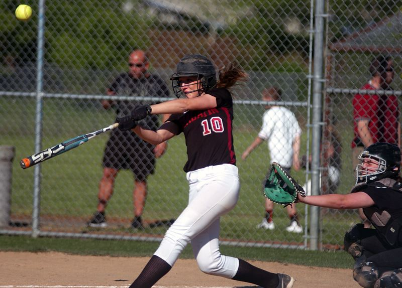 by: DAN BROOD - BOOM -- Tualatin senior Maddie Powelson gets her bat on the ball during the Wolves' win at Tigard.