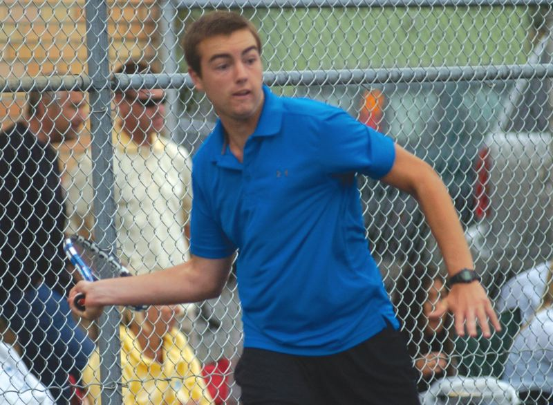 by: THE OUTLOOK: DAVID BALL - Barlows Kyle Helm, above, prepares to smash a forehand shot during his 6-2, 6-1 win in the singles final.