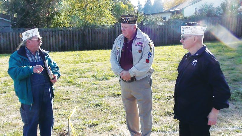 DARRYL SWAN - Local VFW representatives (from left) Ron Urban, Jerry Peal and Frank Weber last October consider the site of a new U.S. Amed Forces Memorial in Scappoose. Next Saturday, May 18, VFW representatives are hosting a dedication ceremony for the new memorial.