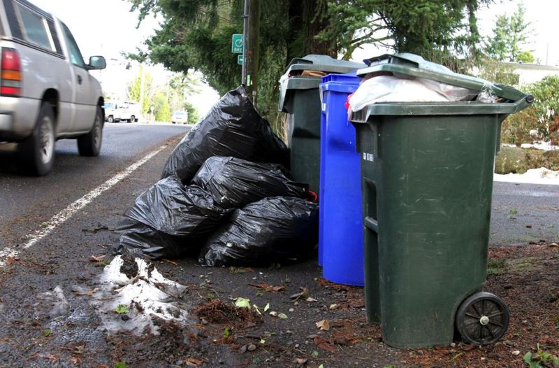 by: TRIBUNE FILE PHOTO - Portland's City Council is considering a new rate schedule that could cut a dime from garbage and recycling rates.