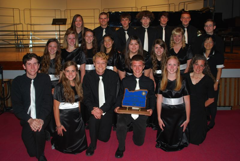 by: PHOTO COURTESY: REBECCA STEELE - North Clackamas Christian School's choir is pictured with its first-place hardware after the statewide championships on Thursday at George Fox University.