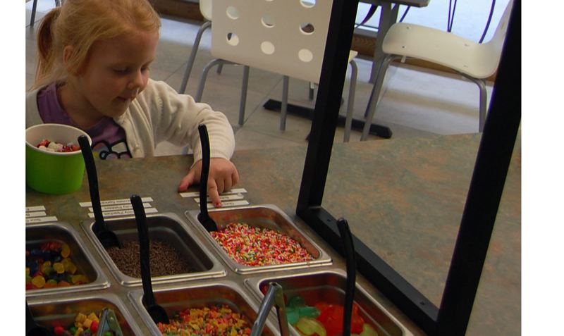 by: PHOTO BY: KYLIE WRAY - Debbie Cameron brings granddaughter Evelyn in for frozen yogurt and colorful butterfly gummies at Oregon City's Yo Factory.