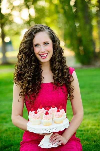 by: SUBMITTED PHOTO - Lizzy Early, a Lake Oswego native, has published Your Cup of Cake, a cookbook of cupcake recipes.