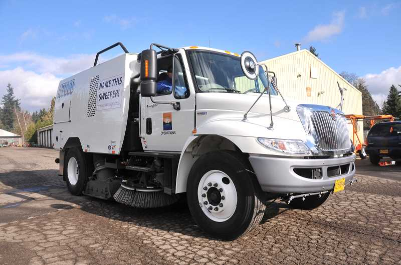 by: VERN UYETAKE - The city's newest street sweeper now has a name: Oscar.