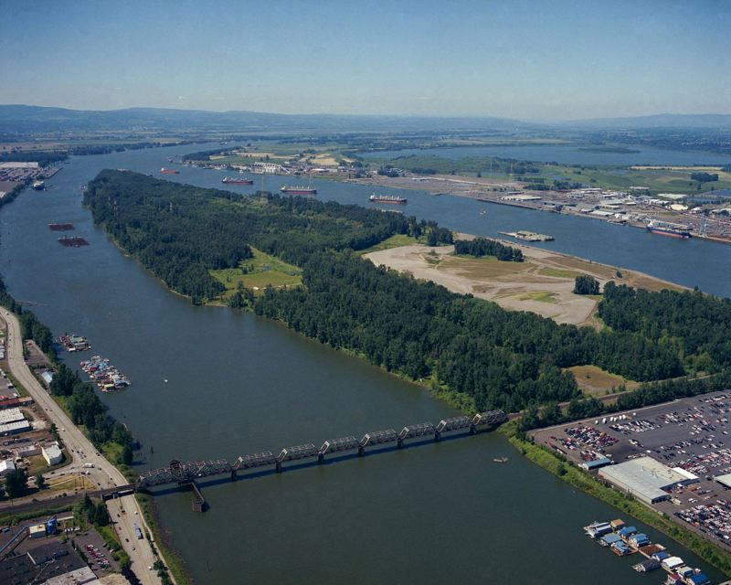 by: TRIBUNE FILE PHOTO - The proposed marine trade terminals would largely be built on the sand-covered part of the island, used to dump material dredged from the Columbia River.