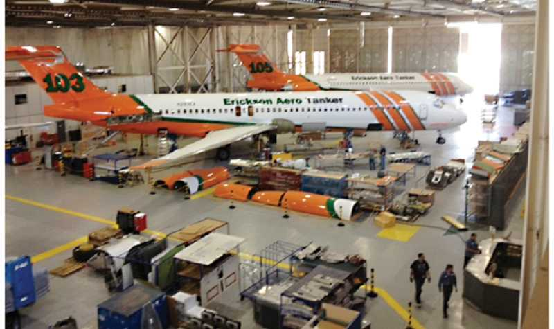 by: PHOTO BY GLEN NEWTON - Two of Erickson Aero Tanker's MD-87s have already been painted with the company logo. The aircraft, still located in Goodyear, Ariz., will eventually be moved to Madras.