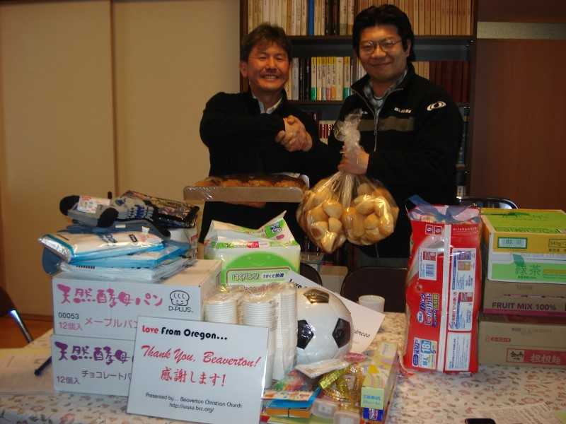 by: SUBMITTED PHOTO - When the tsunami hit, the Sayama church mobilized what resources it had and headed north to the affected areas. Over the next six months, Pastor Takeshi Aida (left) made the 800-mile round trip a dozen times, bringing practical aid to survivors of the tsunami.
