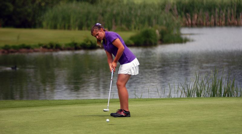 by: DAN BROOD - FINISHING STRONG -- Tualatin junior Hayley Mortensen sinks this putt for par on her final hole at the state tournament.