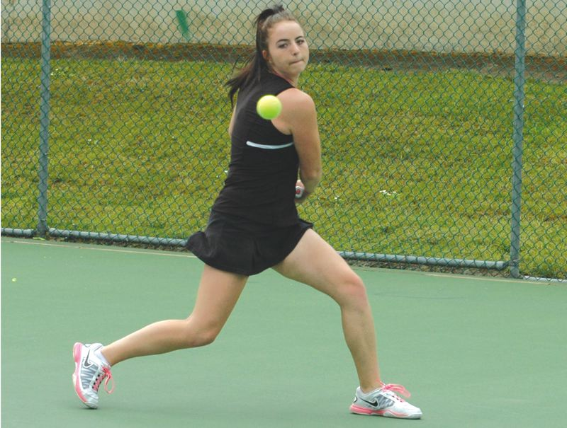 by: SANDY POST: PARKER LEE - Sandy's Christan Schlaht races along the baseline to make a return during her first-round singles match at the 5A state tournament last week.