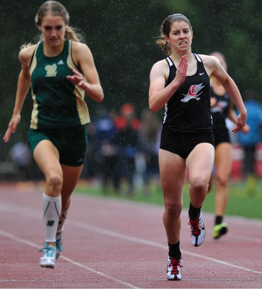 by: JOHN LARIVIERE - With only the fourth best time heading into the meet, Clackamas sophomore Caroline Combs (right) was a surprise state-qualifier in the 400, where she finished second only to West Linns Cara Boucher, completing the race in a personal best of 58.84.