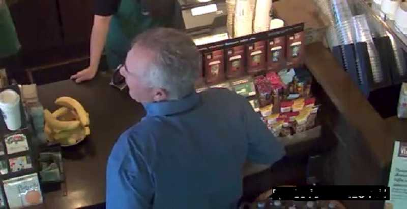 by: SHERWOOD POLICE DEPARTMENT - Here's another shot of the man police would like to question about a camera hidden inside the Sherwood Starbuck's bathroom.