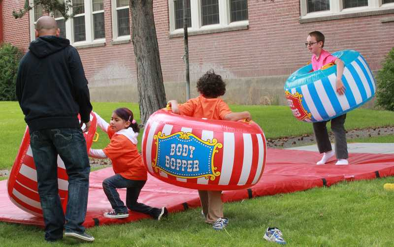 Kids have fun with Bounce House toys at the carnival.