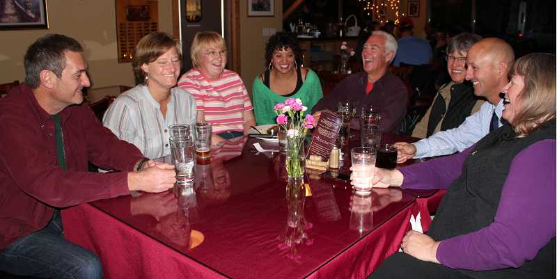 by: HOLLY GILL/THE PIONEER - MAC supporters, from left, Lee and Anita Goodwin, Margaret Kincaid, Patricia Smith, Chuck and Janice Alexander, and Lonnie and Angie Henderson react to positive results for the recreation district levy Tuesday night at Geno's.