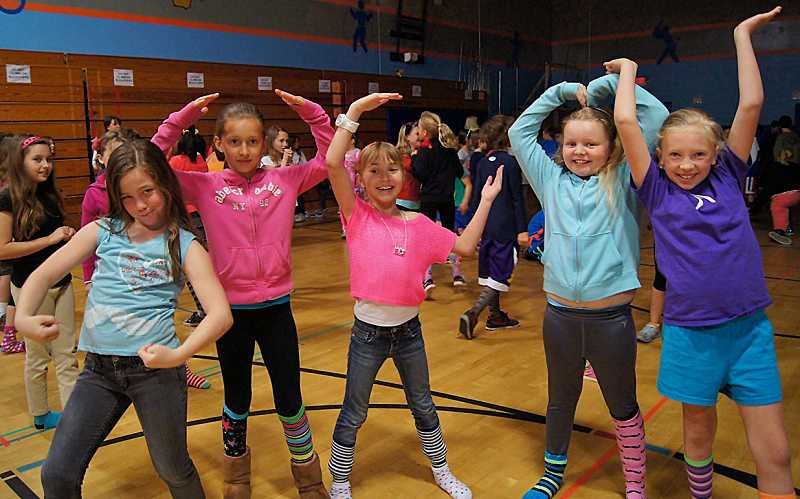 by: SUBMITTED PHOTO: GAYLE MICKEY - Westridge Elementary School students got their groove on during the Silly Sock Dance-a-Thon last week. Olivia Yarmoluk, far left, back row, looks on as a row of dancers kick up their heels, from left: Emma Martin, Katie Dukart, Gabrielle Dover, Hannah Grimes and Abby Seyle.