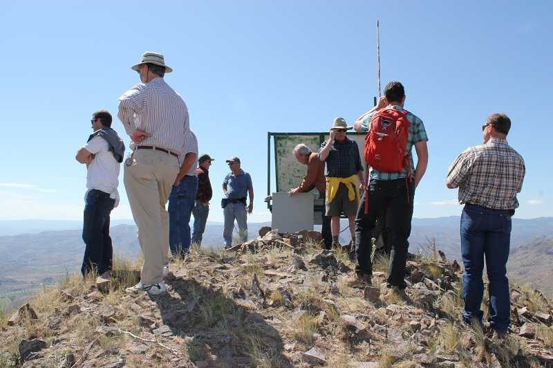 by: HOLLY M. GILL - Jefferson County commissioners and department heads, as well as Cherry Creek Ranch owner Matt Smith, at right, take in the views from the top of Wagner Mountain, which would be part of the proposed Cathedral Rock Wilderness. The commission toured the area on May 15.