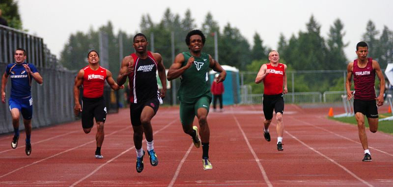 by: DAN BROOD - SUPER SPRINTER -- Tigard senior Cameron Bremner is on his way to victory in the 200-meter dash at the Pacific Conference district meet. Bremner also triumphed in the 100.