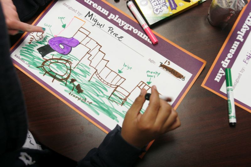 by: OUTLOOK PHOTO: JIM CLARK - Miguel Perez, 13, drew an elaborate depiction of his dream playground in markers Tuesday, May 21.