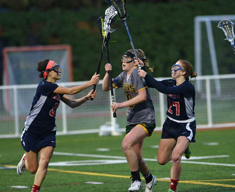 by: TIDINGS PHOTO: VERN UYETAKE - Girls lacrosse