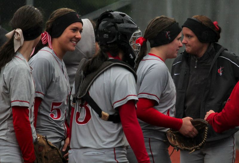 by: JONATHAN HOUSE - Clackamas players head for the dugout after their long first inning with Tualatin. Pictured are (from left) McKenzie Giancola, Melissa Noble, Vanessa Oakden, Madisen Vrabel and Rachel Atchison.