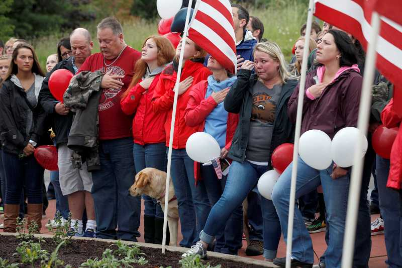 by: TIMES PHOTO: JONATHAN HOUSE - A large crowd gathered together in the Southwest Barrows Road roundabout to remember and honor Andrew Keller and other service men and women who made the ultimate sacrifice while serving in the U.S. Armed Forces.