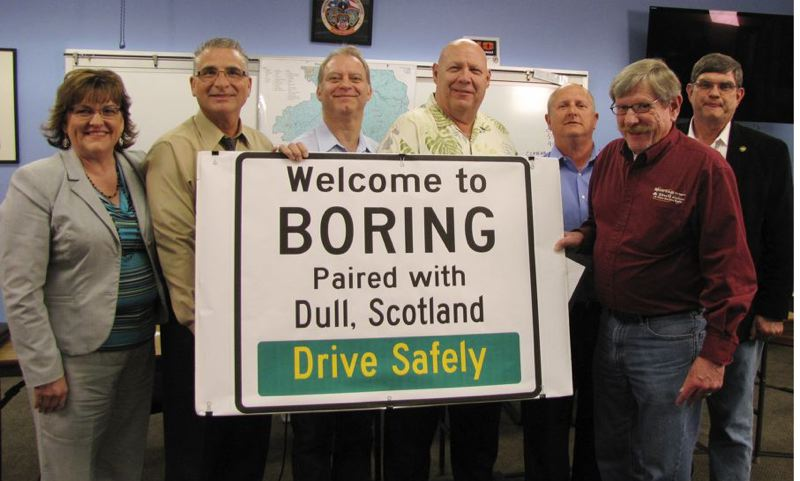 by: CONTRIBUTED PHOTO: CLACKAMAS COUNTY - Holding an enlarged mock-up of the sign recently placed in Boring Station Trailhead Park are, from left, Clackamas County Commissioner Tootie Smith; Rep. Bill Kennemer, R-Oregon City; commissioners Paul Savas, John Ludlow and Jim Bernard; Boring Community Planning Organization Chairman Steve Bates; and Sen. Alan Olsen, R-Canby.