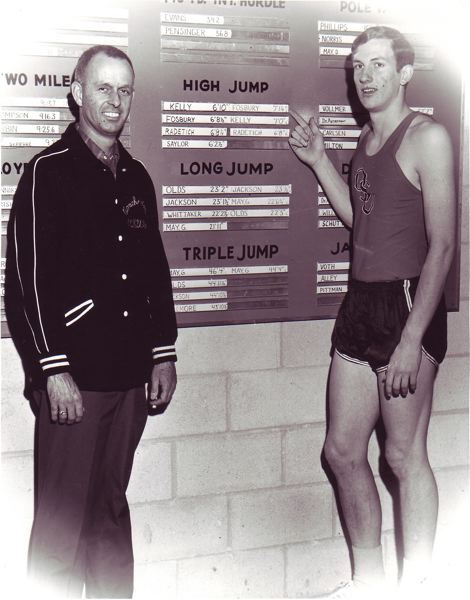 by: COURTESY OF OREGON STATE UNIVERSITY - Berny Wagner (left), Oregon State track and field coach, and the Beavers' Dick Fosbury note the latter's personal best in the high jump.