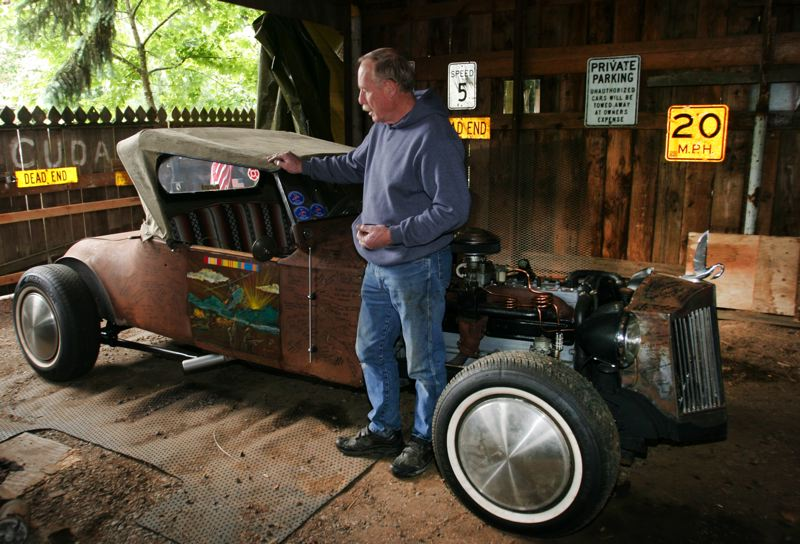 by: OUTLOOK PHOTO: JIM CLARK - Vietnam War veteran Wayne Swanson built a rat rod with the intention of having veterans sign it. He calls it his tribute car.